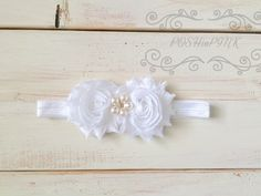 A personal favorite from my Etsy shop https://www.etsy.com/listing/230783514/white-girls-shabby-flower-headband-pearl