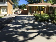Brushed Concrete Driveway in London Ontario Driveway Ideas, Concrete Driveways, Ontario, Shed, Outdoor Structures, London, Garage Ideas, Sheds, Tool Storage