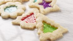 Here's everything you need to make these festive holiday-themed stained glass cookies at home. This recipe requires 4 hours and 20 minutes of prep time, and 12 minutes of cooking Candy Cookies, Sugar Cookies, Savoury Dishes, Food Dishes, Window Cookies, Lifesaver Candy, Frozen Orange Juice Concentrate, Stained Glass Cookies, Biscuits