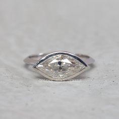#BezelSetRing #AntiqueRing #DiamondRing #ColorlessMoissanite #MoissaniteRing #MarquiseRing #GoldRingForHer #EngagementRing #KnifeEdgeShank #RingForHer #ColorlessMarquise #WeddingRing #WhiteGoldRing