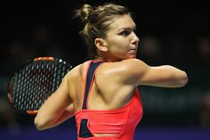 Simona Halep Photos Photos - Simona Halep of Romania plays a forehand in her singles match against Angelique Kerber of Germany during day 3 of the BNP Paribas WTA Finals Singapore at Singapore Sports Hub on October 25, 2016 in Singapore. - BNP Paribas WTA Finals: Singapore 2016 - Day Three