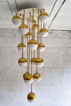 :: Brass & Glass Chandelier By Stilnovo | Italy, 1965 :: Check out Brigette's review of Edmund White's Inside A Pearl: My Years In Paris here: http://chaptersandscenes.wordpress.com/2014/08/01/brigette-reviews-inside-a-pear-my-years-in-paris/