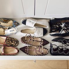 """""""I keep all my heels in their original boxes with a photo at the front with the ones I wear the most at eye level, whilst my flat shoes live in handy pull out drawers."""""""