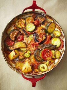 Briam | Greek Vegetable Bake | Ingredients  150	ml	extra-virgin olive oil	, plus extra if required 1	large	aubergine	, halved lengthways, then thickly sliced 1	large	onion, thinly sliced 3	garlic cloves, sliced 800	g	large potatoes	, chopped into 1cm cubes 6	medium tomatoes, thinly sliced 12	cherry tomatoes 5	courgettes, sliced 300	g	tomato passata 1	tbsp	dried oregano 2	tbsp	flat-leaf parsley	, finely chopped