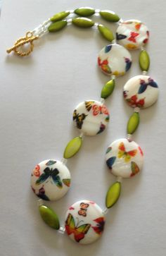 painted shell bead necklace it measures 19 inch long with gold coloured clasp by Jewellerybydenise on Etsy