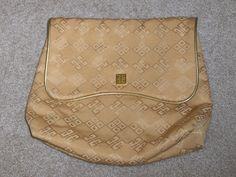http://www.bonanza.com/listings/Givenchy-Gold-Clutch-Handbag-Cosmetic-Bag/42714512