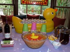 Beverage table for baby shower: put personalized water bottles in bath duck...I've also put the punch in there!