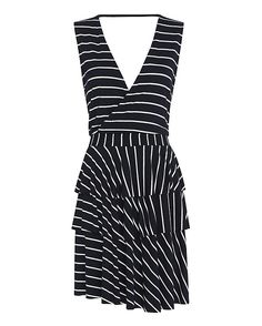 Designers Remix CHARLOTTE ESKILDSEN Carrie Jersey Frill Dress: Raw edge frilly layers begins below the elasticated banded waistline on this jersey dress. Crossover V neckline at front. V back with thin band. Tank straps. In navy/white stripes. Fabric: 96% rayon/4% spandex Made in China.   Model Measurements: Height ...