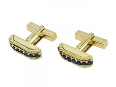 Tiffany & Co Sapphire Cufflinks in 18K Gold  Each set with a row of prong-set sapphires, bordered by rope textured gold, in 18k gold. Signed Tiffany & Co. Italy.
