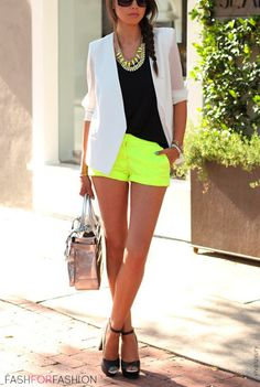 Neon shorts, black tank, white blazer, and black heels.