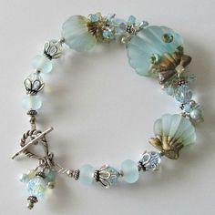 Seashell lampwork bracelet pale aqua lampwork seashell jewelry, sterling silver beaded  bracelet Misty Shores. $235.00, via Etsy.