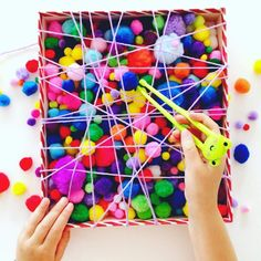 Love this fun fine motor activity @cintaandco created To set it up she simply wrapped wool/yarn around a shoe box lid to create the web effect, and then filled it up with pom-poms. How easy (and cheap) is that?