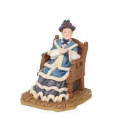 Breiende Angelina in schommelstoel van het merk Luville.