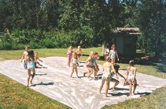 DIY Giant slip and slide for parties -- looks amazing and mr. 7 would love this.