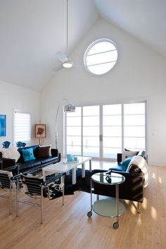 Loft Living Space Decoratingideas Equipped With Black Sofas Set And Blue Cushions Ideas And White Wall Idea: Interesting Black Sofas Appearance In Eye-catching Living Room