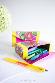 How to make your own bright and cheery pencil case with an empty cardboard snack…