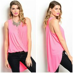 Neon  Pink Tunic! Beautiful criss cross neon pink Tunic Material is polyester and spandex  hi lo style,  price firm unless bundled Tops Tunics