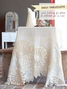 doily table cloth, the prettiest! i am going to do this for a christmas tree skirt :)