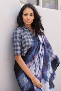 This is inspired by the waves of the ocean. This 100% cotton saree is tie dyed to symbolize waves. This has a check contrast jacket to give a contemporary look. Suitable to wear for a speacial occasion at day or night and best worn with minimal jewelery. These sarees have individual variations from the photo due to the tie dye methods, but follow the same concept.