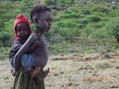 Brother & Sister: A young pokot girl carries her brother as they herd goats - Paka Crater, Baringo Kenya Steve Mccurry, Tanzania, Kenya, Reference Images, Brother Sister, Short Film, Statue, Goats, Children