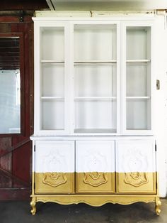 A sad hutch from the 70's got a glam redo with clean satin white paint and a gold-dipped finish!