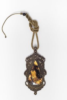 One of a kind macrame amber pendant completely weaved in a high quality polyester waxed thread (doesn´t lose color or shape). This unique piece is