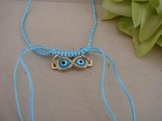 Greek Macrame Turquoise and Blue Evil Eye  Necklace by ForThatSpecialDay on Etsy