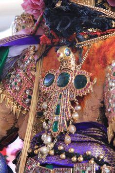 Pendant on the back of a Vishnu deity