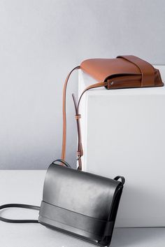 """Size + Fit: - Soft matte leather finish - Length: 9.1"""" / 23cm - Width: 2.2"""" / 5.5cm - Height: 7.5"""" / 19cm Content + Care: - Leather - Spot clean only - Imported"""