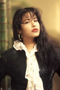 Something in me still loves the Selena Quintanilla true Mexicana look... red lips, gold hoops, penciled eyebrows, and big, dark hair.