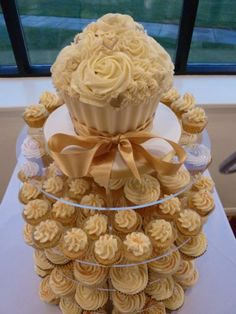 Gold themed wedding cupcake tower... Wedding ideas for brides, grooms, parents & planners ... https://itunes.apple.com/us/app/the-gold-wedding-planner/id498112599?ls=1=8 … plus how to organise an entire wedding, without overspending ♥ The Gold Wedding Planner iPhone App ♥