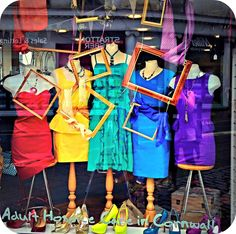This window proves oddments of clothing need not be a challenge, this window is full of colour, depth and interest. Using the frames carefully placed to highlight the detail of the items displayed.
