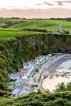 Pennan Village under the cliffs & against the sea, Aberdeenshire, Scotland
