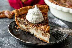 a slice of low carb pecan pie on a black serving plate with a fork and dollop of whipped cream on top Pumpkin Pie Cake, Keto Pumpkin Pie, Low Carb Pecan Pie Recipe, Low Carb Recipes, Keto Stuffing, Keto Muffin Recipe, Pumpkin Chocolate Chip Muffins, Keto Food List, Keto Foods