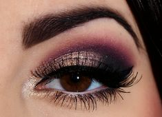 Brown, black, plum purple and champagne gold eye shadow.