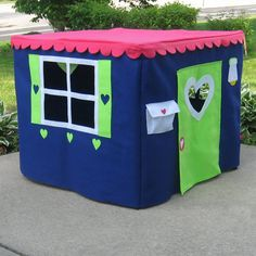 Heres a cute little card table playhouse perfect for any child! Especially great for a family with girls and boys since it incorporates blue and pink with a splash of lime green thrown in for fun!  When checking out, please use the first drop down menu to choose the adhesive or sewn method of making your playhouse. The adhesive method is as effective as sewing, and it is guaranteed for the life of the playhouse. Some aspects of the playhouse will still be sewn (for instance, the door and…