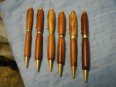 some different wood pens crafted in my woodshop on a lathe