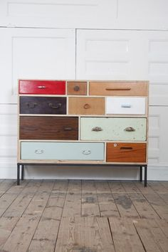 "These are designed by Rupert Blanchard. He says: ""I collect hundreds of drawers, doors, fittings and fixtures before finding the right combination to construct a new piece.  I only use broken, discarded and odd drawers that no longer have a carcass therefore work can often sit unfinished for many months as I search for the elusive, perfect drawer to finish the design.  The search can take me far and wide building relationships with second-hand furniture dealers, car boot sellers, market…"