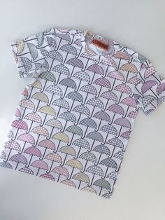Rainbow umbrellas printed on modern jersey, available at Spoonflower.