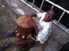 Moinina shows off his musical skills on the drum!
