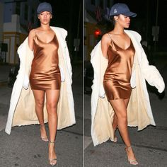 Rihanna wearing AOTC bronze slip dress, Club 75 navy blue Club Cat curved logo cap, Tom Ford silver padlock ankle-strap sandals