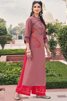To complement your graceful demeanour, andaaz fashion presents this dusty pink rayon trouser suit which features beautiful embroidery work. This collar neck and 3/4th sleeve party wear suit beautified with thread work. Present with rayon palazzo pant in hot pink color with hot pink chiffon dupatta. Palazzo pant has resham work. Dupatta beautified with plain work. #trousersuit #salwarkameez #malaysia #Indianwear #Indiandresses #andaazfashion Pink Trousers, Trouser Suits, Indian Dresses, Indian Outfits, Indian Clothes, Palazzo Suit, Kurta Palazzo, Women Salwar Suit, Purple Fabric