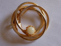 Vintage Gold tone circle brooch with faux pearl by joegems66