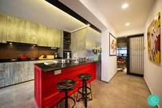 Edgy kitchen with a fire engine red island. #kitchen #island #popart