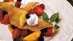 Sour cream, butter and self-rising flour create ultimate melt-in-your-mouth pancakes.