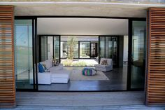 Casa do Pego is a luxury villa designed by Pedro Ferreira Pinto and is located in Comporta, Portugal. Unique modern design, that rises from the sand dunes a few meters away from the best portugues… Spacious Living Room, Home Living Room, Living Room Designs, Living Room Decor, Villa Design, House Design, Minimalist Design, Modern Design, D House