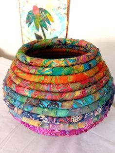 Batik Fabric Coiled Basket Pot by JustJenniferB on Etsy This coiled basket was made with Hoffman's Sunflower batiks and several other Indonesian batiks. The basket is Sewing Crafts, Sewing Projects, Fabric Bowls, Rope Crafts, Fabric Art, Etsy Fabric, Fabric Scraps, Basket Weaving, Rope Basket