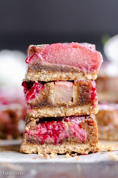 These+Raspberry+Rhubarb+Almond+Bars+have+an+crisp+almond+flour+crust+topped+with+soft+almond+frangipane,+fresh+raspberries,+and+tart+rhubarb.+This+recipe+is+Paleo,+gluten+free+++refined+sugar+free.