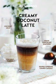 Craving coconut? Try our Creamy Coconut Latte coffee drink. INGREDIENTS: 1 Double Espresso Chiaro capsule; 5 oz unsweetened coconut milk; 1.5 oz finely chopped white chocolate; coconut flakes & white chocolate shavings. MATERIALS: Barista Recipe Maker. HOW TO: Combine coconut milk & chocolate in your Barista on the 'Latte Macchiato' setting. Pour prepared milk into glass until almost full. Brew Double Espresso on top. Garnish with coconut flakes & white chocolate shavings. Enjoy! Coffee Snobs, Coffee Latte, Coffee Drinks, Nespresso Usa, Nespresso Recipes, Coconut Milk Chocolate, White Chocolate, Barista Recipe, Recipe Maker