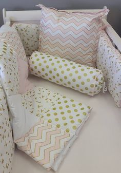 Scatter cushion, bolster pillow, reversible, padded cot bumper and a patch work quilt in blush and gold